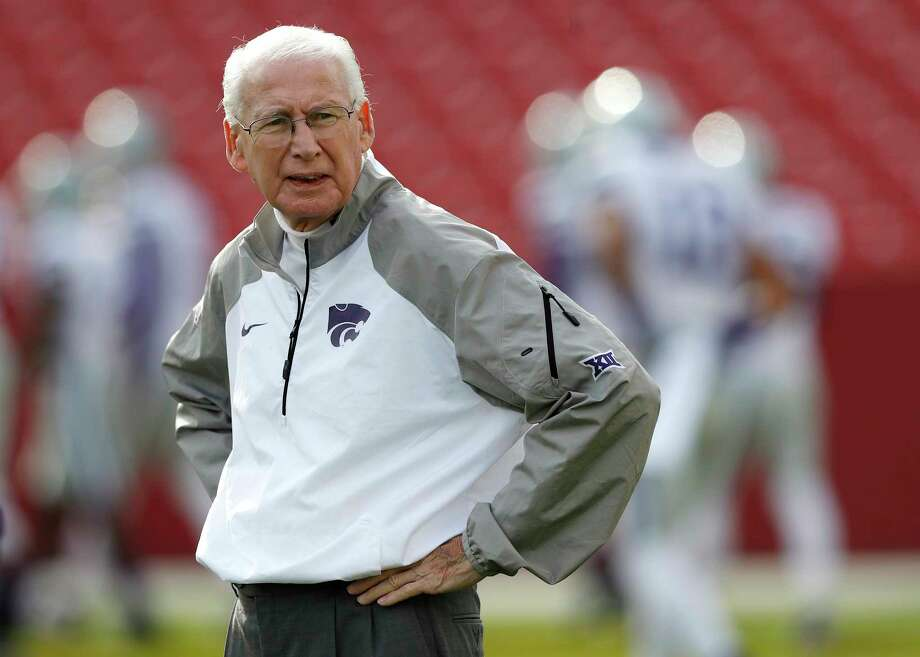 FILE - In this Oct. 29, 2016, file photo, Kansas State coach Bill Snyder stands on the field before the team's NCAA college football game against Iowa State in Ames, Iowa. College athletes will no longer need permission from their coach or school to transfer and receive financial aid from another school. The NCAA Division I Council approved the change Wednesday, June 13, 2018. It takes effect Oct. 15. Standoffs between athletes and coaches over transfers have often led to embarrassing results for schools standing in the way of player who wishes to leave. Last spring at Kansas State, reserve receiver Corey Sutton said he was blocked him from transferring to 35 schools by coach Bill Snyder before the school finally relented after public pressure. (AP Photo/Charlie Neibergall, File) Photo: Charlie Neibergall / Copyright 2016 The Associated Press. All rights reserved.