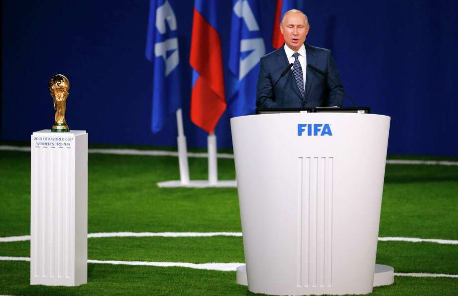 Russian President Vladimir Putin speaks to global soccer leaders at the FIFA congress on the eve of the opener of the 2018 soccer World Cup in Moscow, Russia, Wednesday, June 13, 2018. The congress in Moscow is set to choose the host or hosts for the 2026 World Cup. (AP Photo/Alexander Zemlianichenko) Photo: Alexander Zemlianichenko / AP