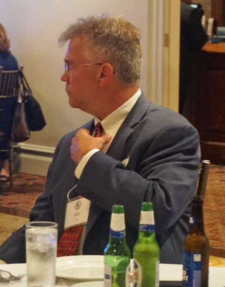 Attorney general candidate John Shaban adjusted his ties during a Greenwich Republican Town Committee event at Gabriele's Italian Steakhouse in Greenwich, Conn. on Wednesday June 13, 2018. Photo: Emilie Munson / Hearst Connecticut Media / Connecticut Post