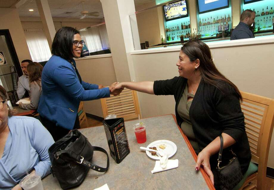 Lieuteanant governor candidate Eva Bermudez Zimmerman, of Newtown, left, greets Maria Valle during a fundraiser for her Wednesday at Sazon Y Mambo in Bridgeport. Zimmerman plans to face party-endorsed candiddate Susan Bysiewicz in an Aug. 14. primary. Photo: Christian Abraham / Hearst Connecticut Media / Connecticut Post
