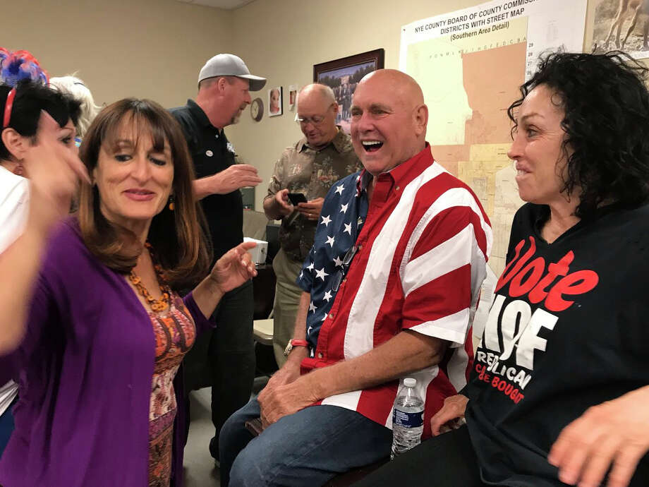 "This Tuesday, June 12, 2018 photo shows Nevada brothel owner Dennis Hof, second from right celebrating after winning the primary election in Pahrump, Nev. Hof, the owner of half a dozen legal brothels in Nevada and star of the HBO adult reality series ""Cathouse,"" won a Republican primary for the state Legislature on Tuesday, ousting a three-term lawmaker. (David Montero /Los Angeles Times via AP) Photo: David Montero / © Los Angeles Times"