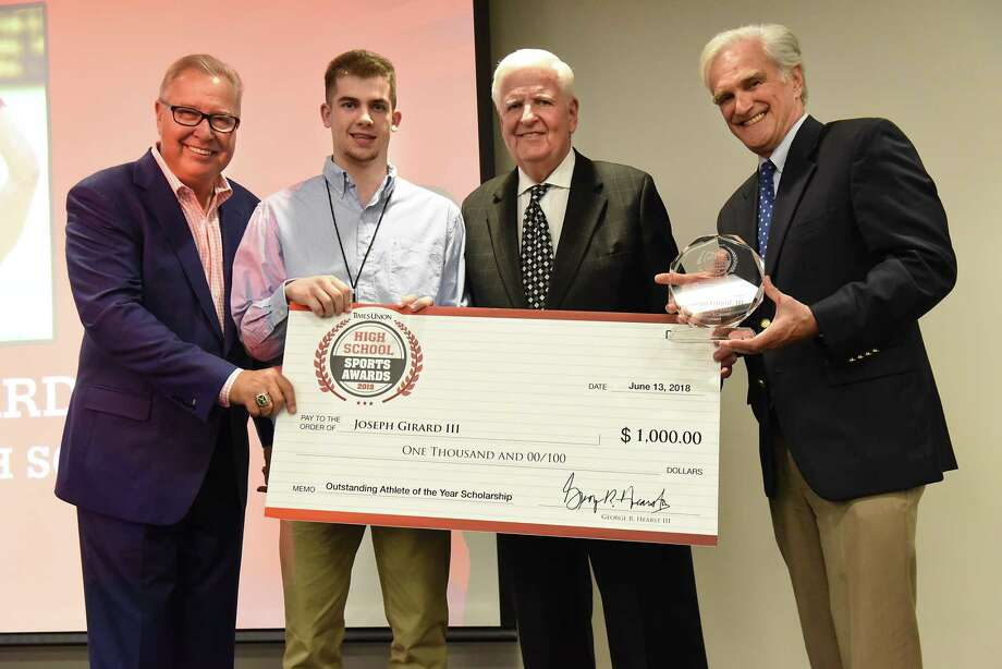 Glens Falls High School star basketball player Joseph Girard, lll, second from left, stands with former NFL quarterback and ESPN analyst Ron Jaworski, left, Robert Curley, New York Chairman of Berkshire Bank, second from right and Times Union Editor Rex Smith during the Times Union's Inaugural High School Sports Awards at the Hearst Media Center on Wednesday, June 13, 2018 in Colonie, N.Y. Joseph won the male Outstanding Athlete of the Year Scholarship award. (Lori Van Buren/Times Union) Photo: Lori Van Buren / 20043995A
