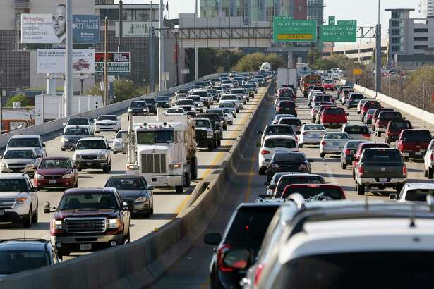Traffic on Interstate 45 in Houston's central business district slowly moves north and southbound during afternoon rush hour on Feb. 23, 2017.