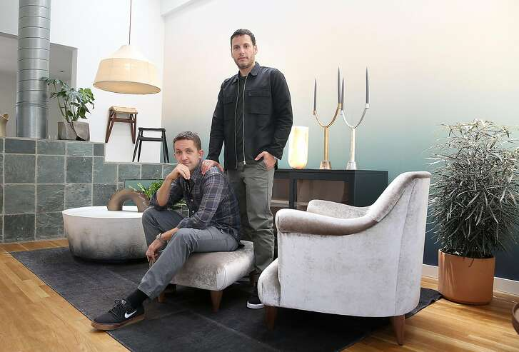 Jason Duzansky (left) and owner David Alhadeff (right) show their living room at home on Thursday, May 10, 2018 in San Francisco, Calif.