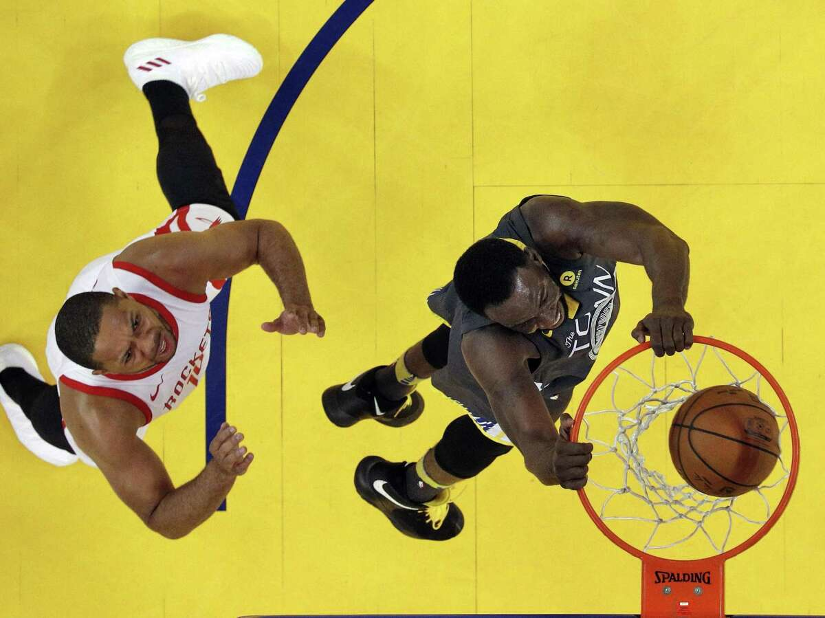 Warriors' Draymond Green dunks over Rockets' Eric Gordon as the Golden State Warriors played the Houston Rockets in Game 4 of the Western Conference Finals at Oracle Arena on Tuesday, May 22, 2018