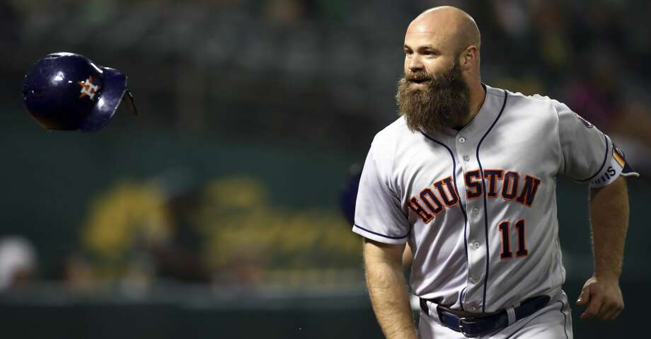 Houston Astros' Evan Gattis flips his helmet after hitting a home run off Oakland Athletics' Danny Coulombe during the seventh inning of a baseball game Wednesday, June 13, 2018, in Oakland, Calif. (AP Photo/Ben Margot) Photo: Ben Margot/Associated Press