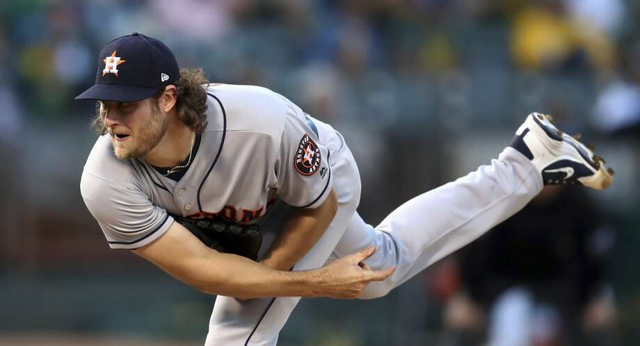Houston Astros pitcher Gerrit Cole follows through on a delivery to an Oakland Athletics batter during the first inning of a baseball game Wednesday, June 13, 2018, in Oakland, Calif. (AP Photo/Ben Margot) Photo: Ben Margot/Associated Press