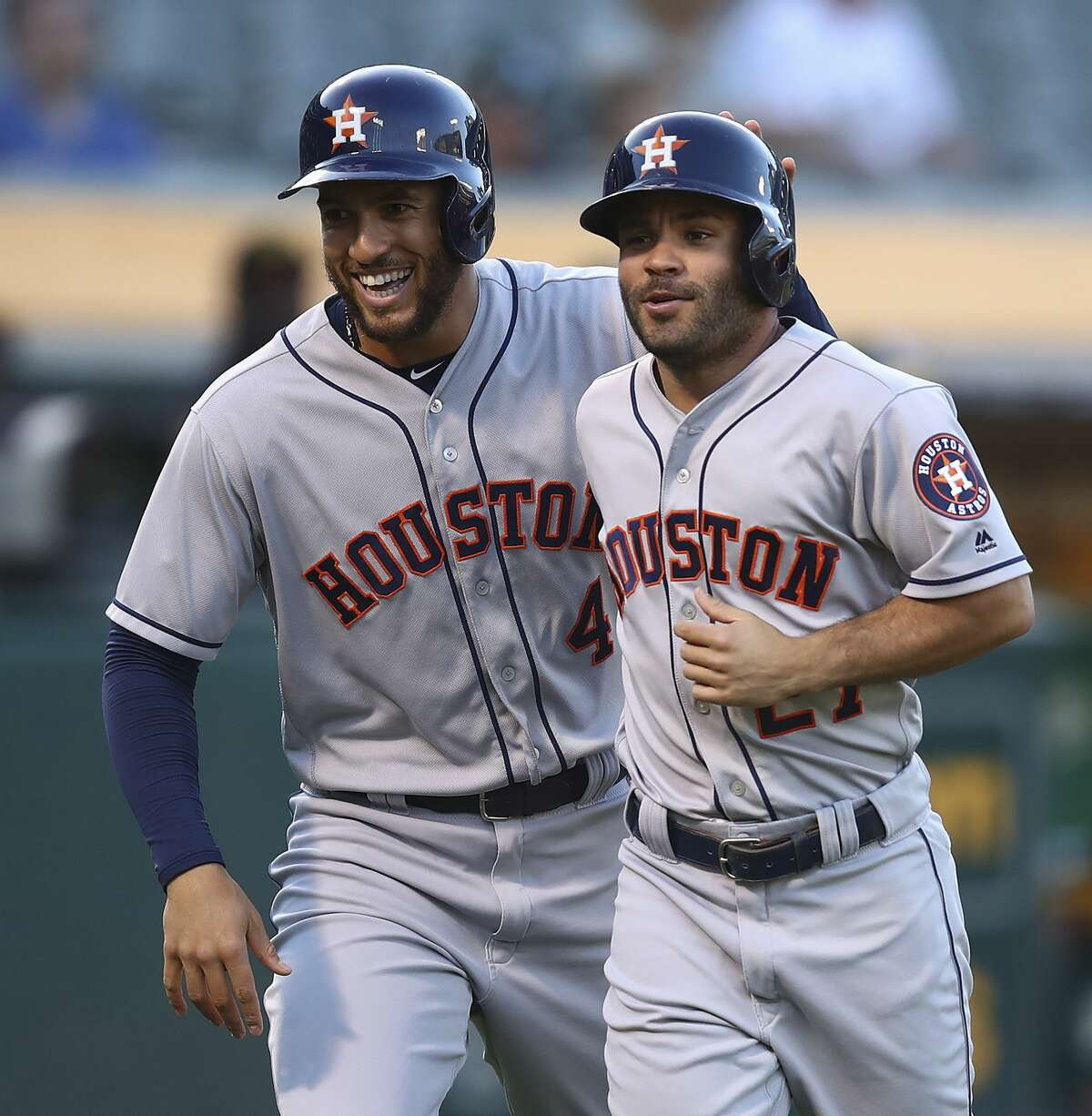 Houston Astros' George Springer, left, and Jose Altuve celebrate after scoring against the Oakland Athletics during the first inning of a baseball game Wednesday, June 13, 2018, in Oakland, Calif. (AP Photo/Ben Margot)