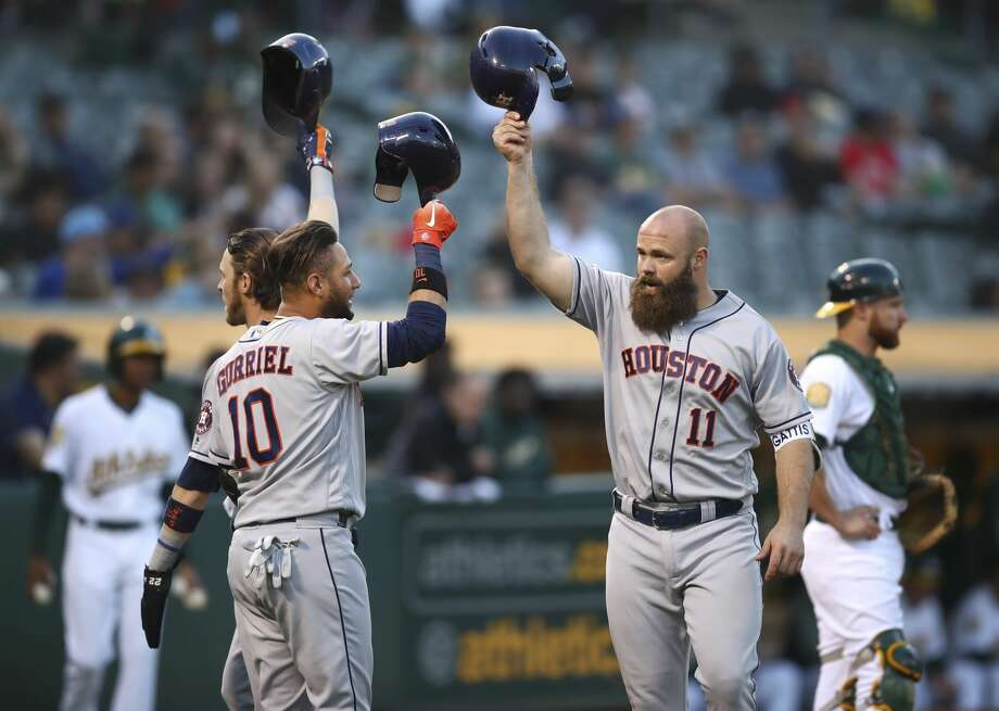 Houston Astros' Evan Gattis, right, celebrates with Yuli Gurriel (10) and Josh Reddick, left, after hitting a three-run home run off Oakland Athletics' Emilio Pagan during the second inning of a baseball game Wednesday, June 13, 2018, in Oakland, Calif. (AP Photo/Ben Margot) Photo: Ben Margot/Associated Press