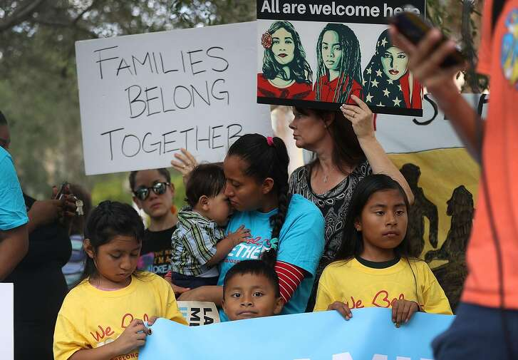 MIRAMAR, FL - JUNE 01:  Protesters join together during a rally in front of the Miramar ICE detention facility on the National Day of Action for Children on June 1, 2018 in Miramar, Florida. The day of action was held to ask the Trump administration to keep families together as they seek legal status in the U.S.  (Photo by Joe Raedle/Getty Images)
