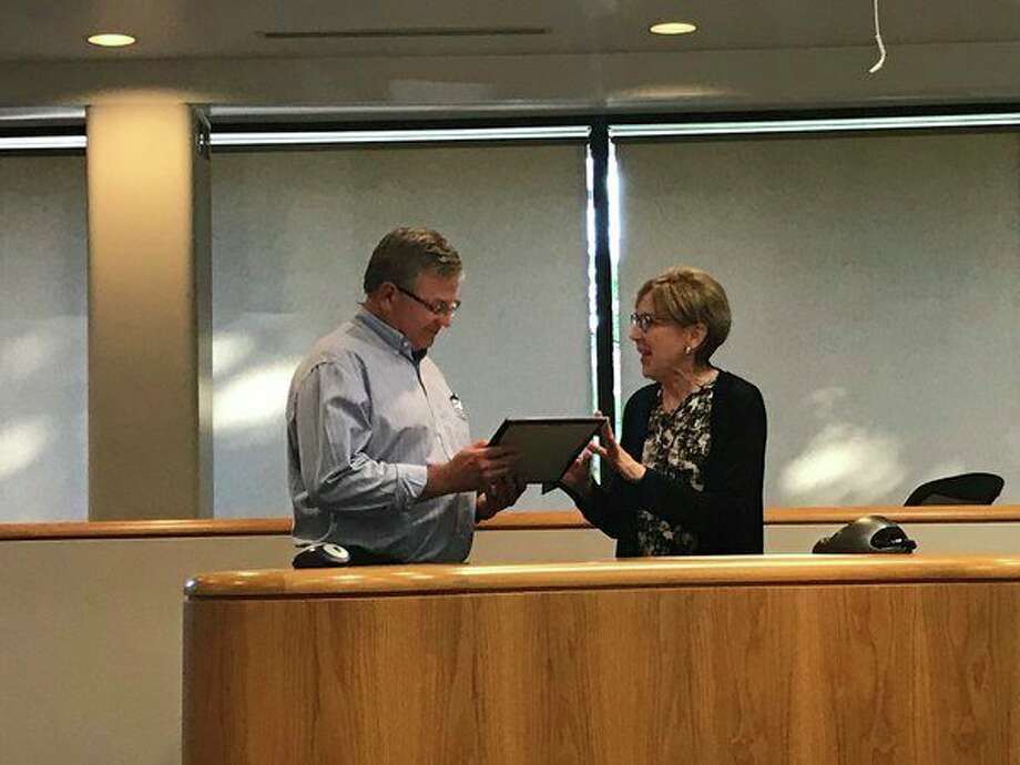 Mayor Maureen Donker presents Midland Amateur Radio Club President Al Bailey with a proclamation dubbing the week of June 18-24 as Amateur Radio Week in Midland.