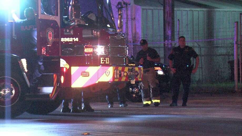 A man with a moped struck a fire truck as they were battling a blaze in the 100 block of West Lubbock Street. Photo: Ken Branca