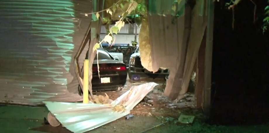 A woman crashed through a SW Houston building on Wednesday, June 13, 2018. Photo: Metro Video
