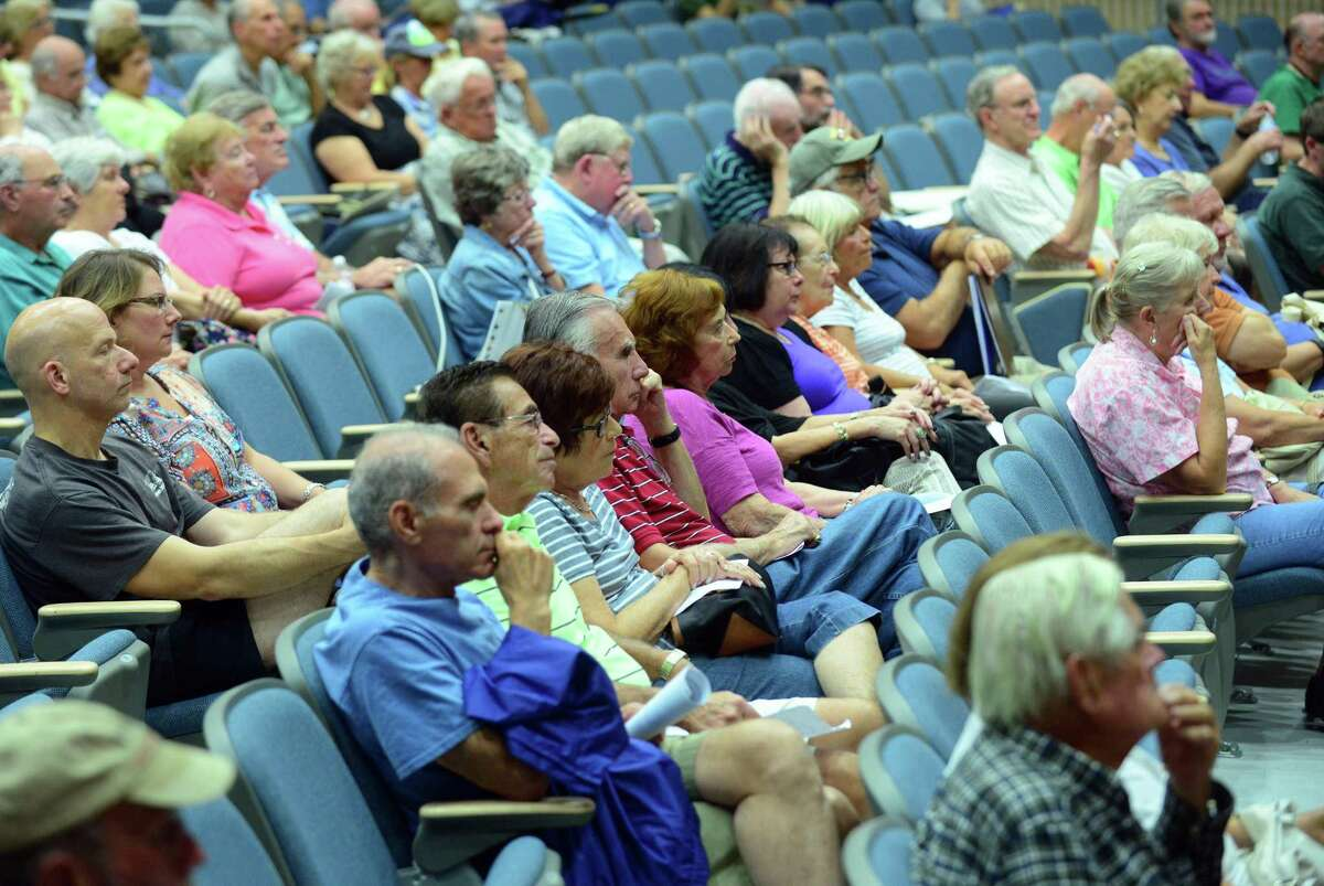 Hundreds of residents attend a public hearing at Oxford High School to voice concerns about the proposed natural gas power plant in Oxford, Conn., on Thursday Sept. 17, 2015. Protesters from 350CT and the Sierra Club were also on hand to chant, march and carry signs to voice their opposition.