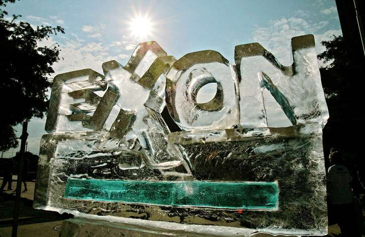 In this May 31, 2006 file photo, an ice sculpture fashioned by protesters, to demonstrate their view of how the company's policies are affecting the environment, slowly melts outside the Exxon Mobil shareholders meeting in Dallas. The Massachusetts Supreme Judicial Court ruled Friday, April 13, 2018, that Exxon Mobil must hand over documents for Attorney General Maura Healey's probe into whether the company misled investors and consumers about what it knew about the link between fossil fuels and climate change.