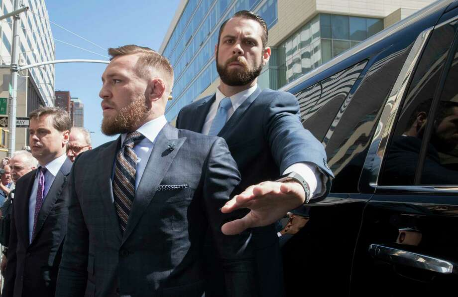Mixed martial arts fighter Conor McGregor leaves a Brooklyn Supreme court, Thursday, June 14, 2018, in New York.  McGregor is in plea negotiations to resolve charges stemming from a backstage melee at a Brooklyn arena. The 29-year-old Irish fighter and co-defendant Cian Cowley remained free on bail after a brief court appearance on Thursday. They are due back in court July 26.  (AP Photo/Mary Altaffer) Photo: Mary Altaffer, Associated Press / Copyright 2018 The Associated Press. All rights reserved.