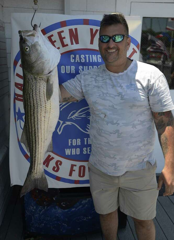 Over two dozen Combat Wounded of Disabled Veterans participated in the 5th Annual Hooks for Heroes Charity Fishing Tournament at the Halloween Yacht Club in Stamford, Conn. on Saturday, June 25, 2016. The event brought together area Veterans and several injured Vets from the Walter Reed Army Hospital for a day of fishing on the Long Island Sound. Several thousands of dollars were raised to help benefit Operation Gift Cards, one of several charity's supporting combat wounded vets. Photo: Matthew Brown / Hearst Connecticut Media / Stamford Advocate