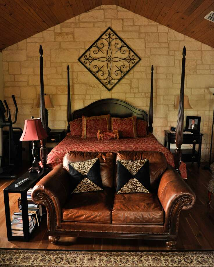A large bed and leather couch make the bedroom comfortable and cozy in a San Antonio area home. Photo: ROBIN JERSTAD / SPECIAL TO THE EXPRESS-NEWS / SAN ANTONIO EXPRESS-NEWS