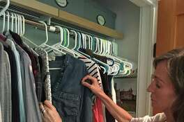 Trish McQuillen, who launched Style Design to help others with their wardrobes, works with a customer who needs help transitioning into a more professional look.