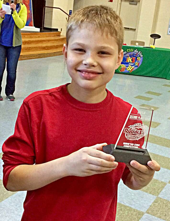 Jackson Drew, who attends Macdonough Elementary School in Middletown, is the second fastest child in the state at solving a Rubik's Cube. Photo: Contributed Photo