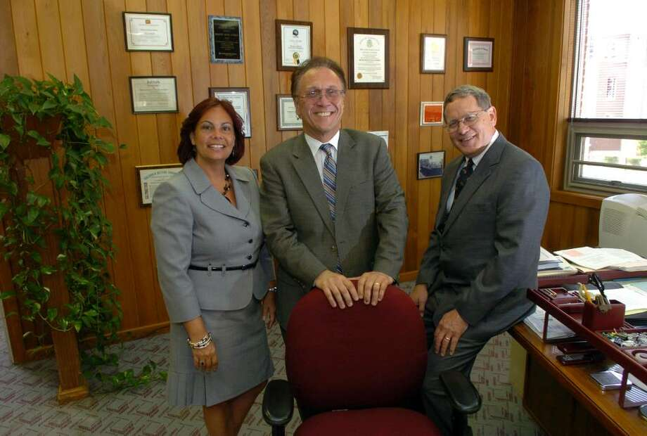 Housing Executive Director Nick Calase, in center, has named two new co-deputy directors to the Bridgeport Housing Authority, shown here at headquarters in Bridgeport, Conn. on Tuesday July 06, 2010. On the left is Blanca Carrasquillo and at right is Peter Hance. Photo: Christian Abraham / Connecticut Post