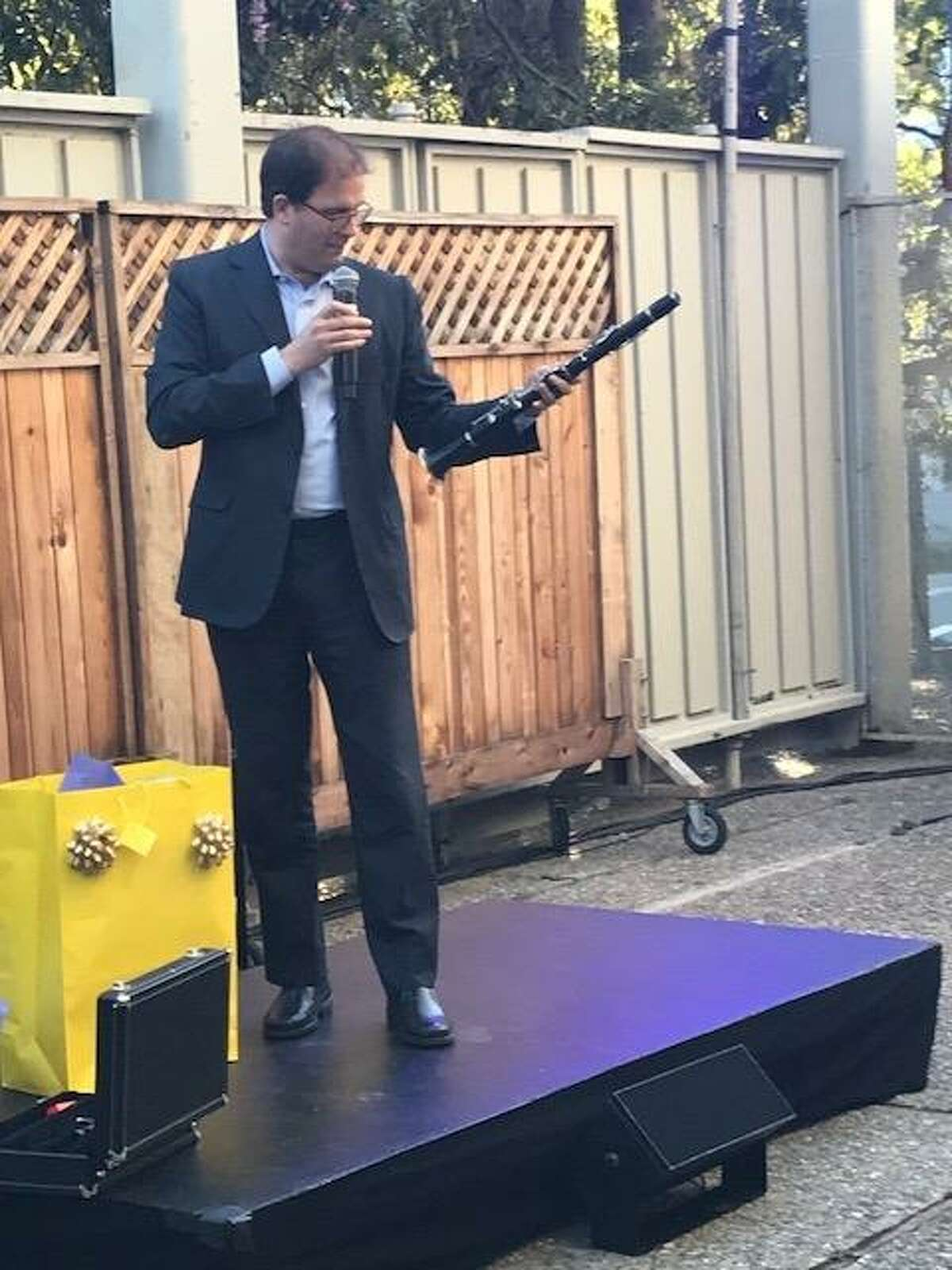 Matias Tarnopolsky accepts good-by gift, a Selmer 1010 clarinet