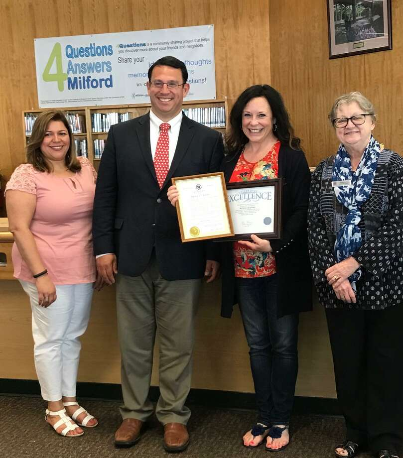 From left are City of Milford Human Resources Director Tania Barnes, Mayor Ben Blake, library staffer and employee of the month Ronda Zalenski and Assistant Library Director Nancy Abbey. Photo: Contributed Photo / Hearst Connecticut Media
