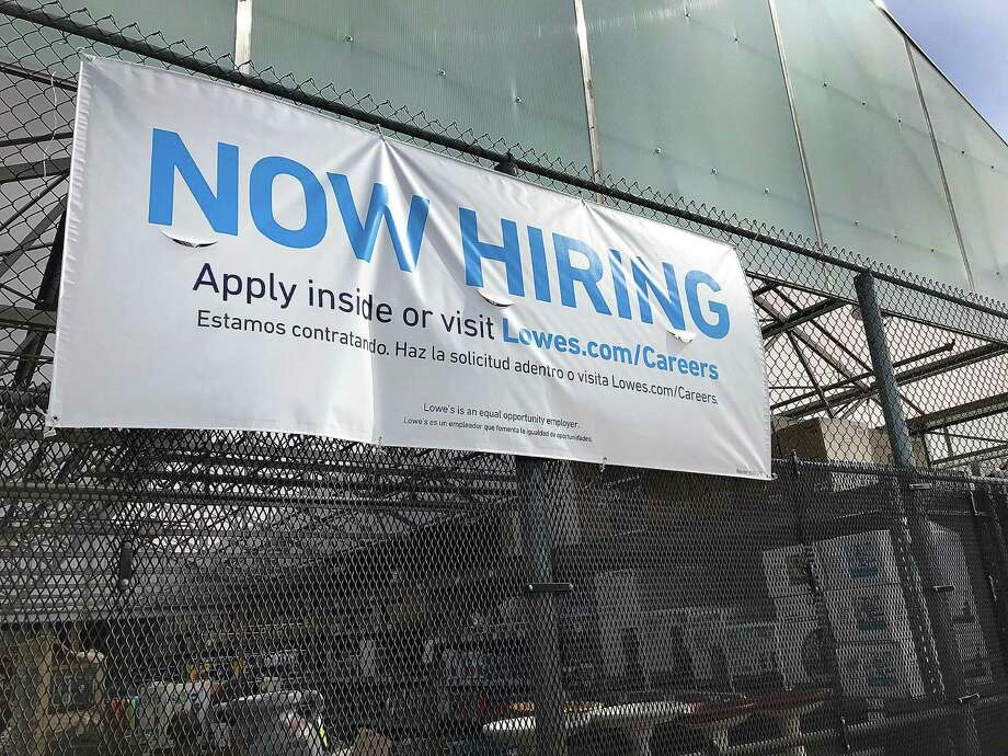 A sign notes that the Lowe's home improvement center in Danbury, Conn., is hiring during the spring of 2018. Photo: Chris Bosak / Hearst Connecticut Media / The News-Times