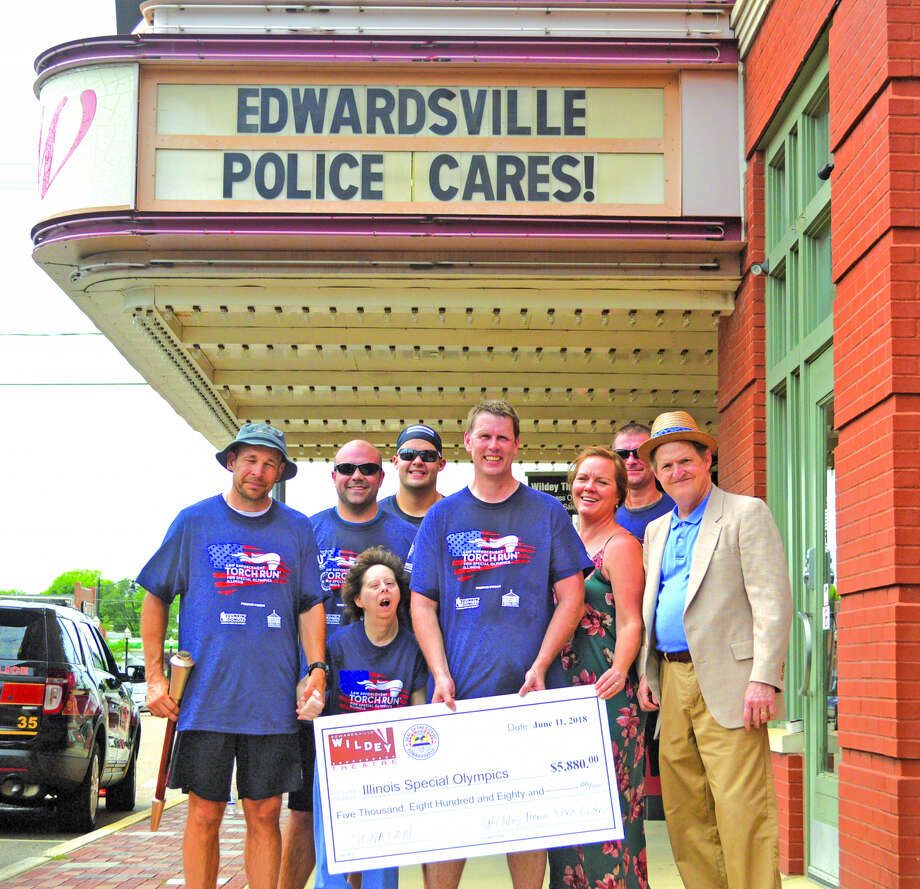 The Wildey Theater made a check presentation for $5,880 for Special Olympics to the Edwardsville Police Department on Monday afternoon during the Special Olympics Torch Run. From left to right are Edwardsville police officers Justin Towell and Mark Lask, Special Olympics athlete Lisa Newbury, Edwardsville police officers Jackson Nolan and Mike Fillback, Wildey Theater assistant manager Janel Ellsworth, Edwardsville police dispatcher James Henghold and Wildey Theatre manager Al Canal.