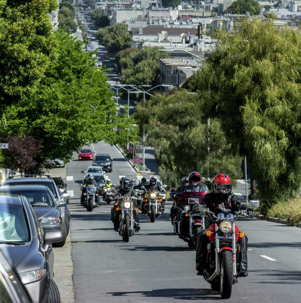 Members of the Dykes on Bikes ride up Guerrero Street in San Francisco on May 28 during a memorial ride for Soni Wolf.