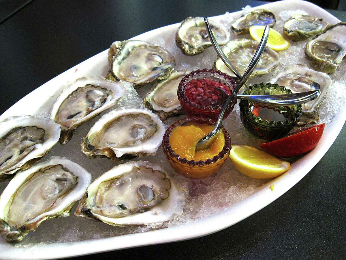 A baker's dozen fresh oysters with apricot cocktail sauce, mignonette and chile oil from the restaurant at the St. Anthony hotel. Rebelle offers both gulf and east coast oysters.