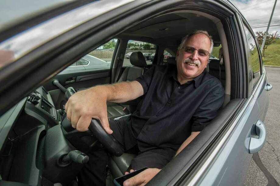 Former Mayor of Schenectady Al Jurczynski smiles from his Uber ride at Mohawk Mall Thursday June 14, 2018 in Niskayuna, N.Y.  (Skip Dickstein/Times Union) Photo: SKIP DICKSTEIN, Albany Times Union / 20044120A