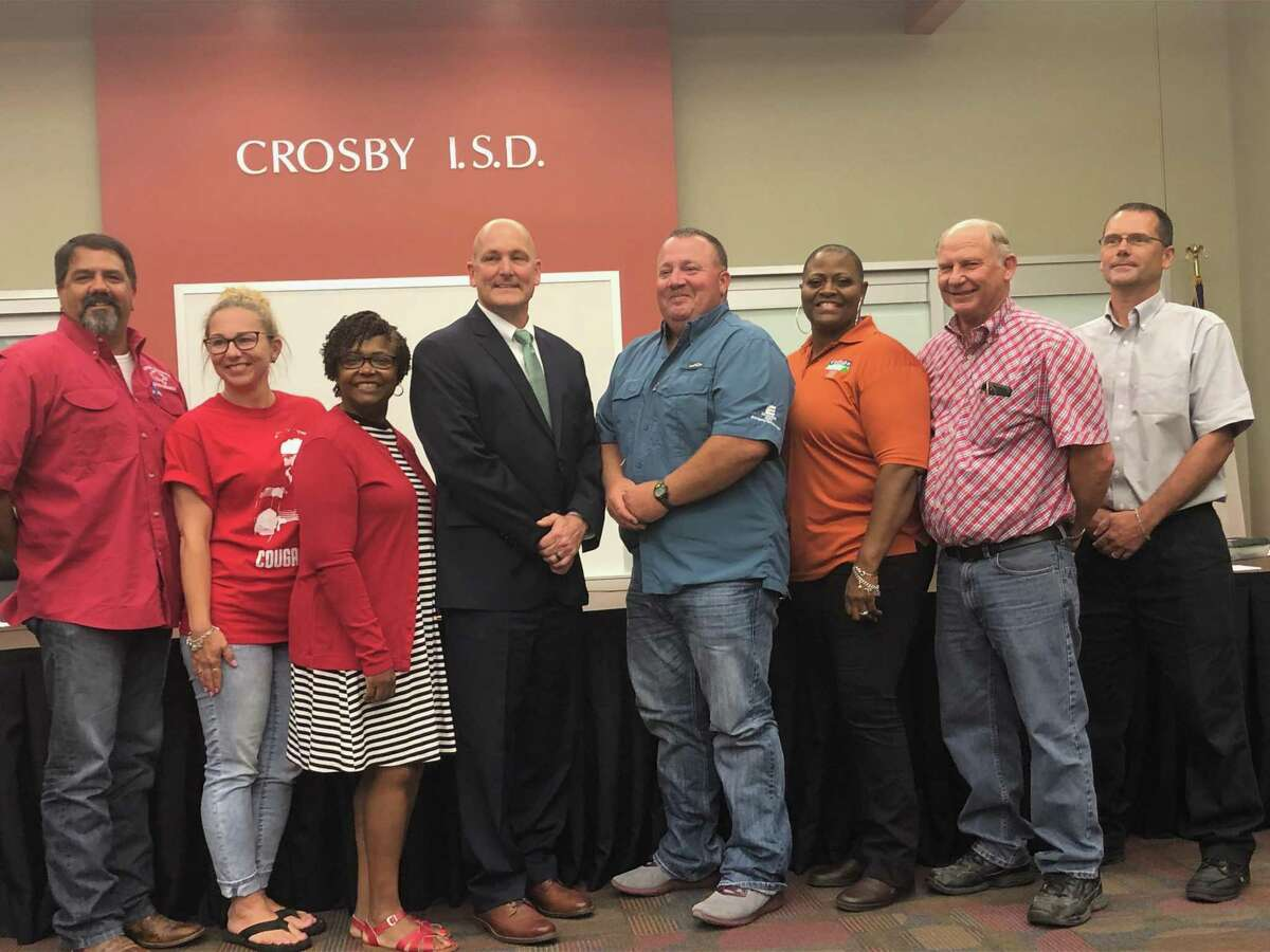 Scott Davis (center, in the black suit) was unanimously approved to be Crosby ISD's next superintendent at a special board meeting on June 12