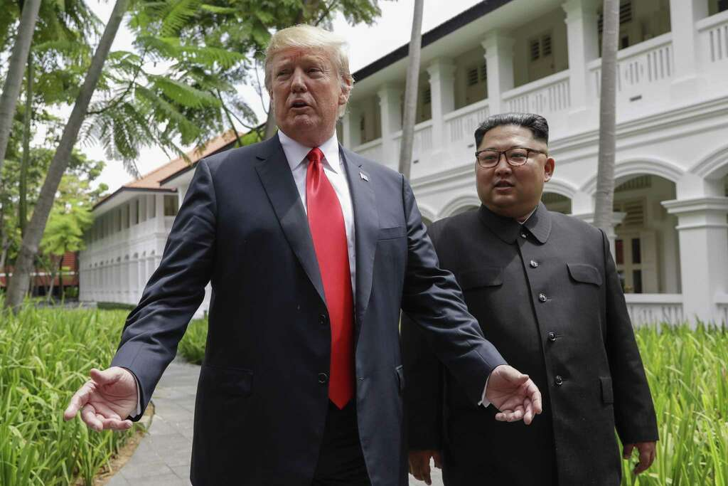U.S. President Donald Trump and North Korea leader Kim Jong Un stop to talk with the media as they walk from their lunch at the Capella resort on Sentosa Island Tuesday, June 12, 2018 in Singapore. Photo: Evan Vucci / Associated Press / Copyright 2018 The Associated Press. All rights reserved