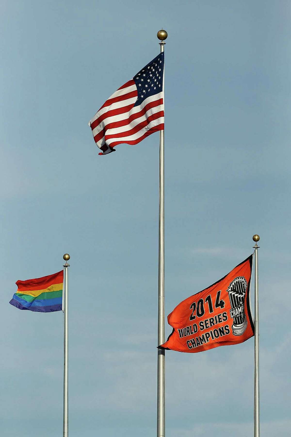 SAN FRANCISCO, CA - JUNE 26: A rainbow flag flies alongside the American flag and 2014 World Series Champions flag on LGBT Night before the game between the San Francisco Giants and the Colorado Rockies at AT&T Park on June 26, 2015 in San Francisco, California. (Photo by Lachlan Cunningham/Getty Images)