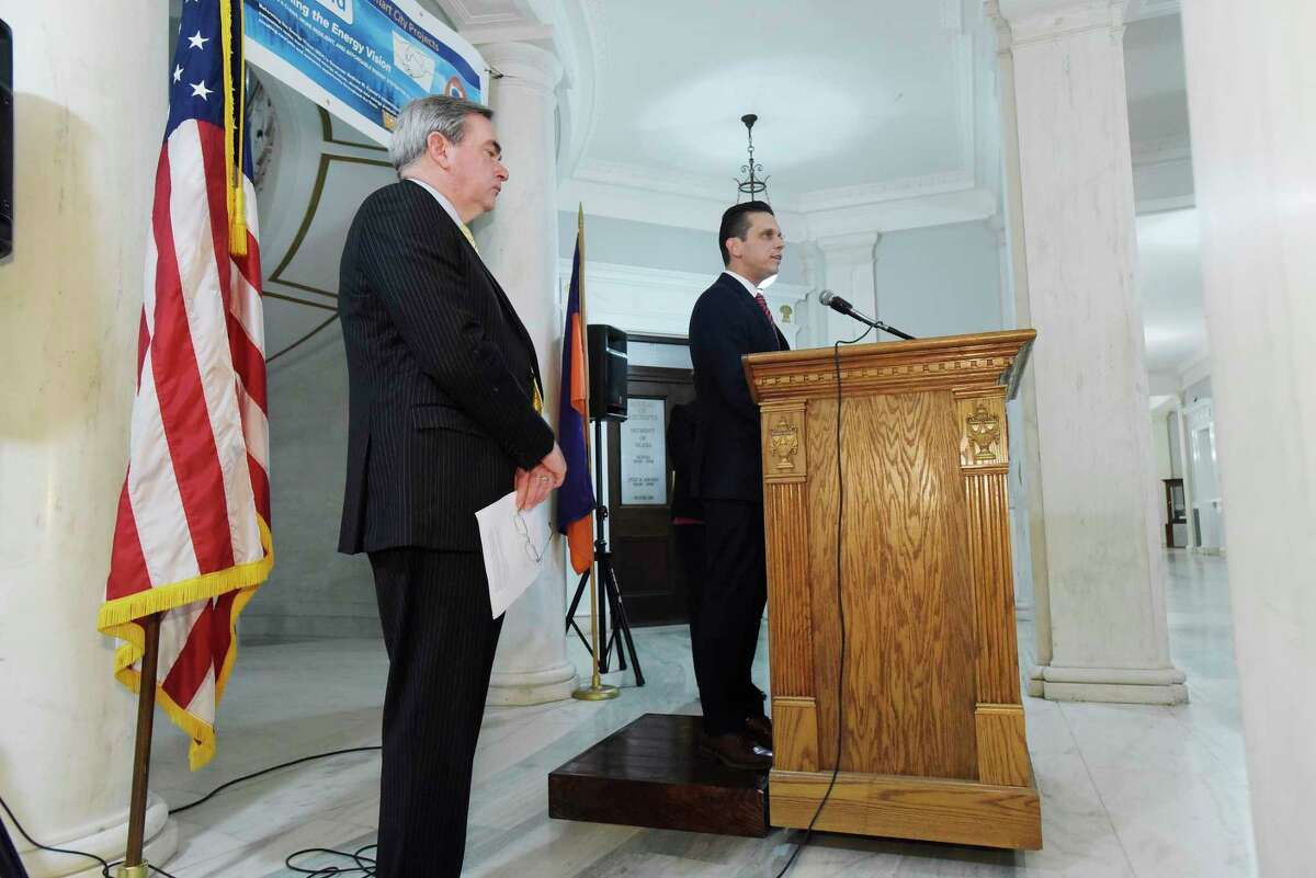 Schenectady Mayor Gary McCarthy, left, and State Assemblymember Angelo Santabarbara take part in a press conference on Thursday, June 14, 2018, in Schenectady, N.Y. where it was announced that National Grid and the City of Schenectady have received approval from the New York Department of Public Service to proceed with a joint initiative to transform the City of Schenectady into a