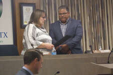 Mayor Pro Tem Susan Blackerby reads a proclamation honoring John Gatica for his service on the Plainview City Council at Tuesday's meeting prior to his resignation as District 6 representative. Gatica has moved to Slaton. A special election will be held Sept. 22 to fell his vacant seat.