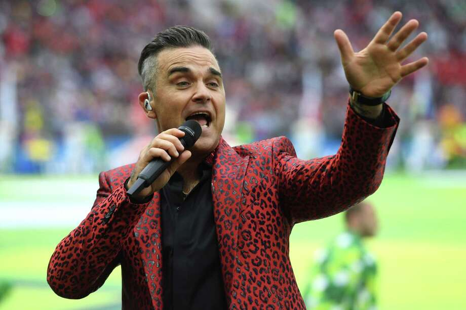 English musician Robbie Williams briefly paused his performance during the Russia World Cup opening ceremony on June 14, 2018 to shoot the finger at TV cameras. Click through to see the gesture, which was captured on live TV. Photo: PATRIK STOLLARZ, AFP/Getty Images / AFP OR LICENSORS