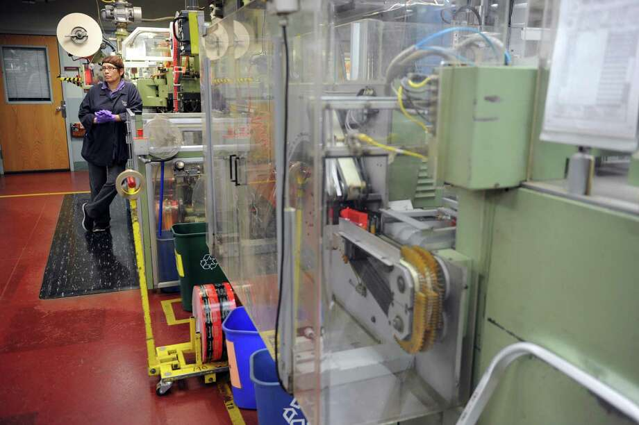A tea-bagging machine at Bigelow Tea headquarters in Fairfield, which recently was awarded status as a benefit corporation. Photo: Autumn Driscoll / File Photo / Connecticut Post