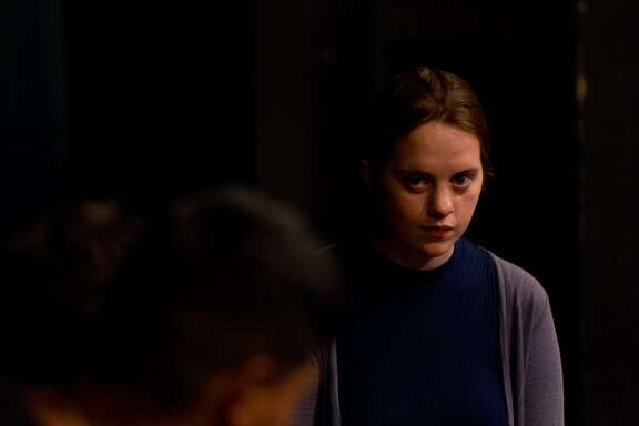 """Trinity University student Julia Palmer plays a young woman who visits her family to share news about a change in her HIV status in """"End Stigma, End HIV/AIDS: A Forum Theatre Project."""""""