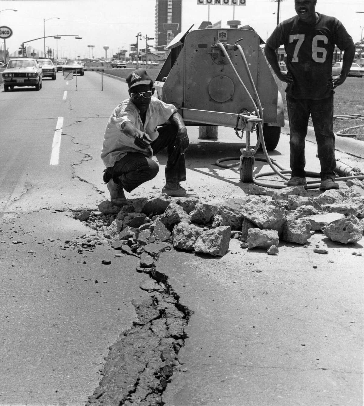 June 1972: This pavement, buckled by heat, is on Bellaire near Fondren. John C. Jones, a hammer operator for the City of Houston, and a crew of workers were on the job repairing it. A spokesman for the City Public Works Department, said widespread buckling by heat usually occurs toward the end of the summer.