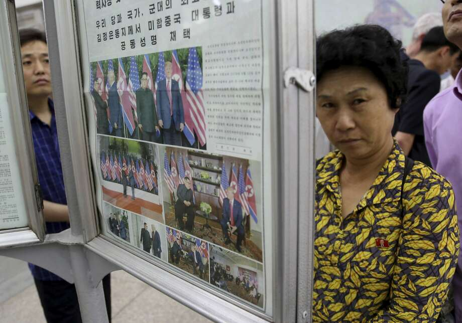People read a newspaper dominated with news on the summit at a subway station in Pyongyang. Photo: Dita Alangkara / Associated Press
