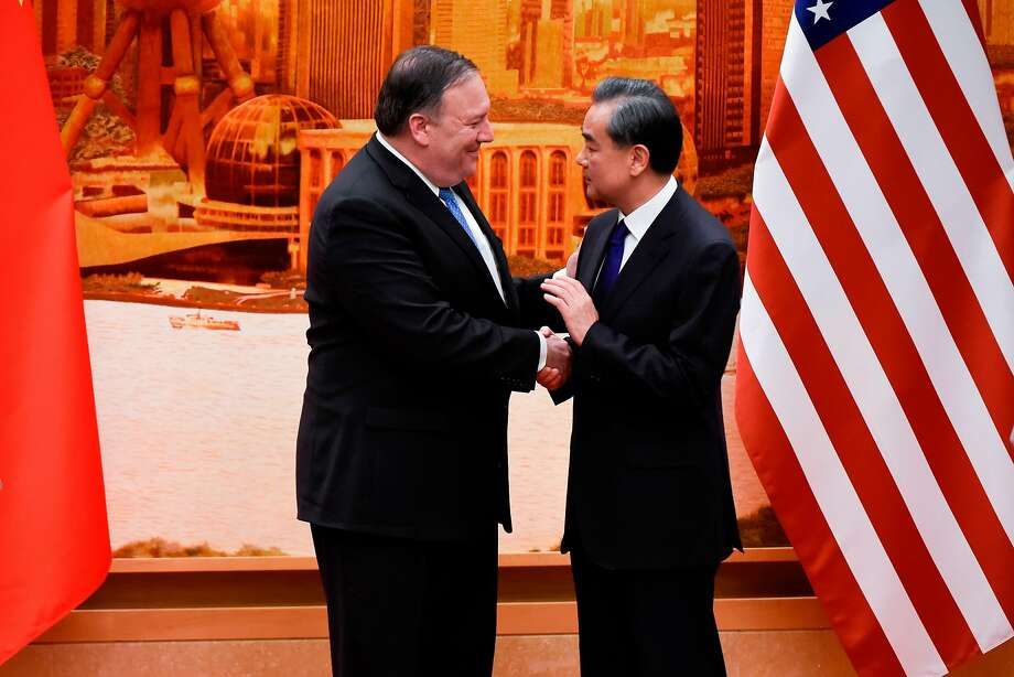 Secretary of State Mike Pompeo shakes hands with Chinese Foreign Minister Wang Yi in Beijing. Photo: Wang Zhao / AFP / Getty Images