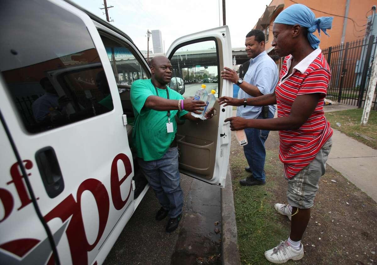 June 2011: Charles Williams hands water bottles to Tasha Davis as the