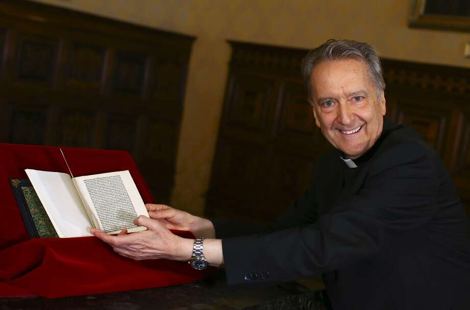 Monsignor Cesare Pasini, chief of the Vatican Library, flips through the rare copy of the letter. Photo: Tony Gentile / AFP / Getty Images