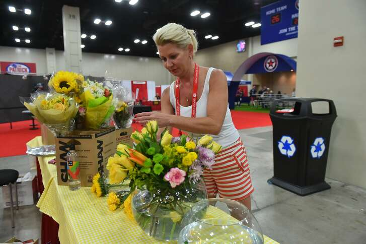 Laura Olson puts together a flower arrangement at the Henry B. Gonzalez Convention Center as the Texas Republican Convention gets underway.