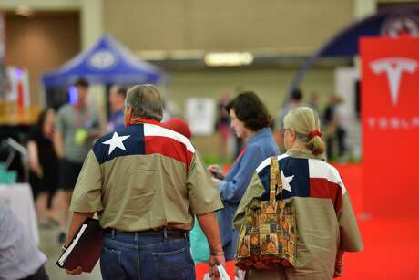 A couple walks in the vendor area at the 2018 Texas Republican Convention. For at least 20 years, the conservative LGBT group Log Cabin Republicans has been denied a booth at the convention. Efforts to secure their presence at this year's convention in Houston failed.