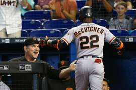 MIAMI, FL - JUNE 14:  Andrew McCutchen #22 of the San Francisco Giants celebrates with manager Bruce Bochy #15 after hitting a two-run home run in the first inning against the Miami Marlins at Marlins Park on June 14, 2018 in Miami, Florida.  (Photo by Michael Reaves/Getty Images)