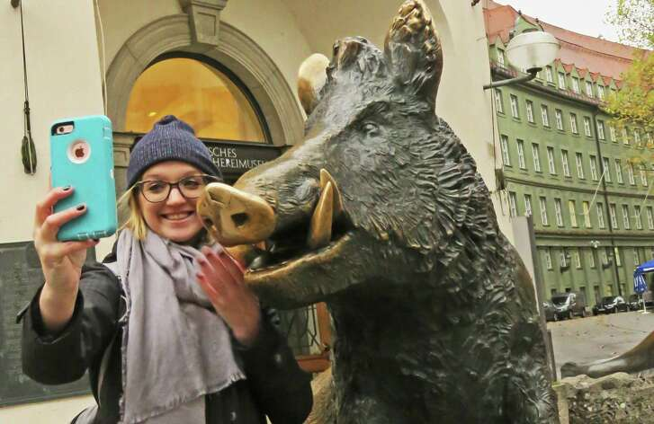 A bronze statue of a wild boar is a popular spot to pose for photos outside Munich's German Hunting and Fishing Museum, which is housed in a Gothic building that was part of the Augustinian Church founded in the 1200s.