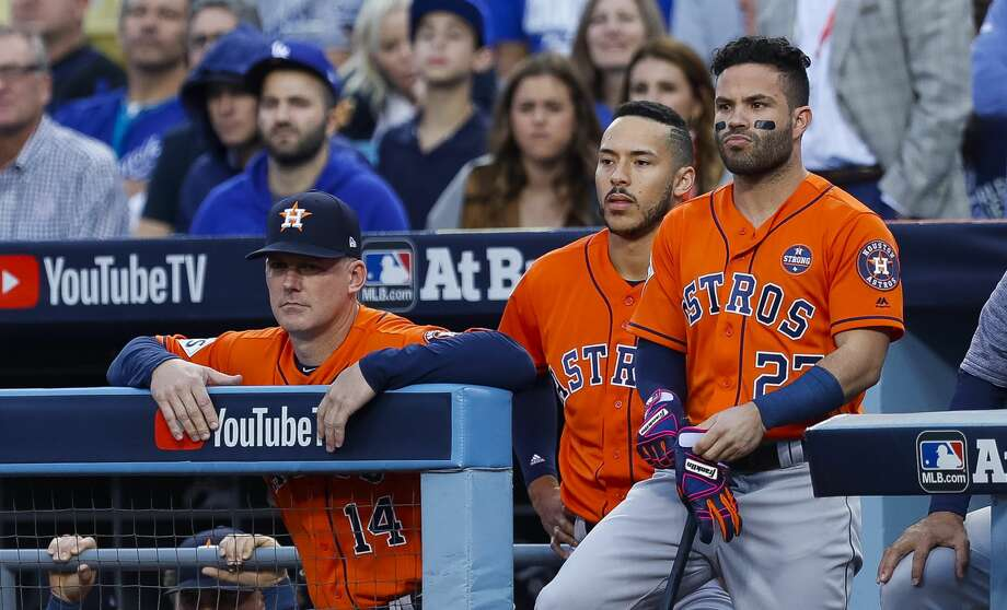 Houston Astros manager A.J. Hinch (14), shortstop Carlos Correa (1) and Houston Astros second baseman Jose Altuve (27) watch from the dugout during the first inning of Game 7 of the World Series at Dodger Stadium on Wednesday, Nov. 1, 2017, in Los Angeles. ( Brett Coomer / Houston Chronicle ) Photo: Brett Coomer/Houston Chronicle